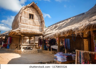 Traditional design of the exterior of SASAK houses in Lombok Island, Indonesia. Frame and roof are made of wood, bamboo and straw leaves of coconut trees.