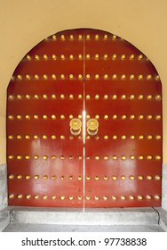 traditional design  red door with bronze dot at Temple of Heaven in Beijing, China