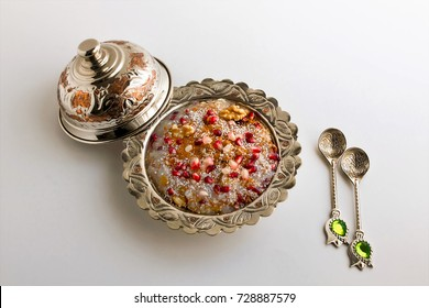 Traditional dessert Asure (Noah's Pudding) in a traditional silver bowl on white background