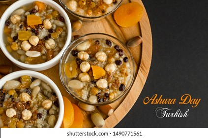 Traditional Dessert Asure,Ashura,Noah's Pudding in bowls on the wooden round plate.Half view from above and written in English by italic font :Ashura Day,Turkish.
