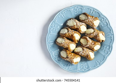 Traditional dessert Cannoli Siciliani stuffed with ricotta cream