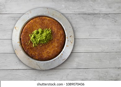 Traditional dessert kunefe over white table, top view, copy space