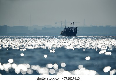 Traditional dhows against backlight, Bahrain