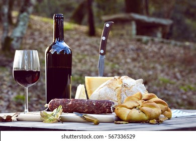 Traditional dinner of Sardinia made of cheese, sausage, bread and wine. / Traditional Dinner of Sardinia