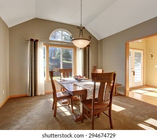 Traditional dinning room with tan carpet, in beautiful northwest home.