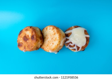 Traditional dish cooked from curd flour and eggs fried сырники with condensed milk closeup on a blue background