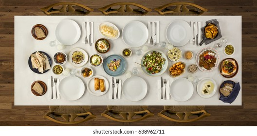 Traditional dishes on the big wooden table