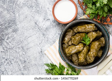 Traditional dolma  (sarma) in grape leaves with copyspace. Lebanon turkish greek middle eastern cuisine. Dinner food dolmadakia/