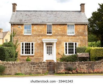 A traditional, double fronted house in the cotswolds, England