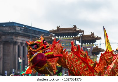 The traditional dragon dance captured in front of the paifang in Liverpool's Chinatown district in February 2018 during the Chinese spring festival.