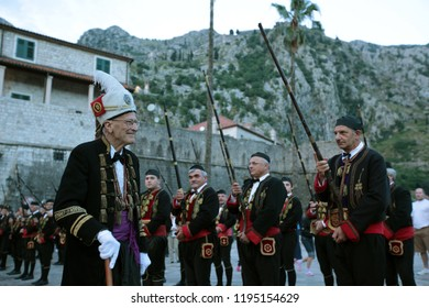 traditional dresst people at a traditional ceremony in old town of the city Kotor on the kotor bay in Montenegro in the balkan in east europe.   Montenegro, Podgorica, April, 2013