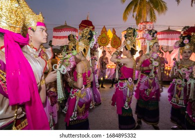 traditional dresst thai people at the Loy Krathong Festival in the Historical Park in Sukhothai in the Provinz Sukhothai in Thailand.   Thailand, Sukhothai, November, 2019