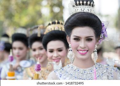 traditional dresst thai women at the Loy Krathong Festival in the Historical Park in Sukhothai in the Provinz Sukhothai in Thailand.   Thailand, Sukhothai, November, 2018