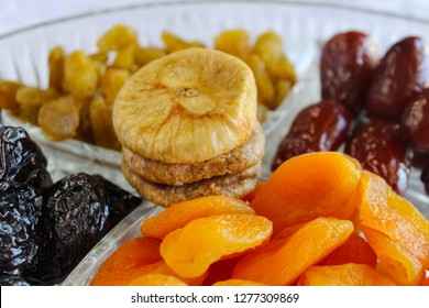 Traditional dried fruits for Jewish holiday Tu Bishvat in a glass tray: Apricots, Dates, Raisins, Prunes, Figs. Israel