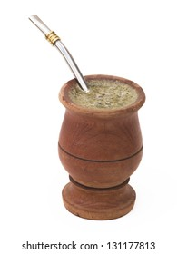 Traditional drink from South America, an infusion of Yerba Mate (Ilex paraguariensis), served on a wooden cup, isolated over white. Clipping path included.