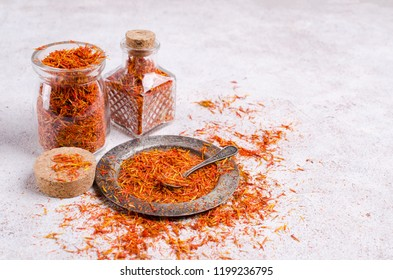 Traditional dry saffron spice on stone background. Selective focus.