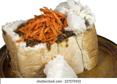 traditional durban mutton bunny chow with carrot and coriander sambal