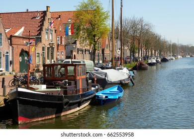 Traditional Dutch Botter Fishing Boats in the small Harbor of the Historic Fishing Village in Netherlands.