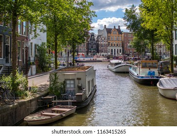 Traditional dutch buildings on canal in Amsterdam