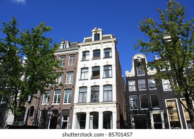 Traditional dutch canal houses in Amsterdam