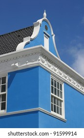 Traditional Dutch colonial style building in blue.