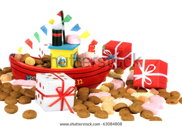 Traditional dutch culture: The steamboat from santa claus with gingernuts and presents at 5th december santa claus feast