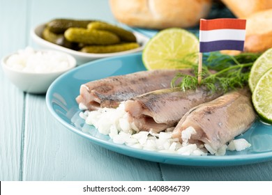 Traditional dutch food freshly salted herring fish with onion called hollandse nieuwe. European food concept with copy space.