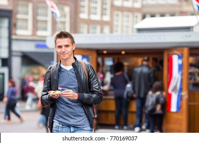 Traditional dutch food: herring fish with onion in fastfood market of Amsterdam, Netherlands