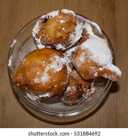Traditional Dutch food on the table on 31 december, sugered donuts, called oliebollen
