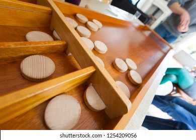 Traditional Dutch game called sjoelen. The wooden disks have to go in the holes