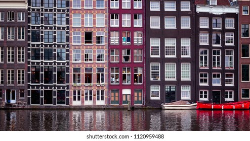 Traditional Dutch houses along the canal and the red boat..