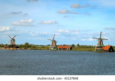 Traditional Dutch landscape with windmills.