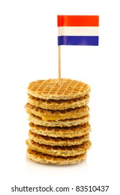 """traditional Dutch mini  waffles called """"stroopwafels""""  with a Dutch flag toothpick on a white background"""
