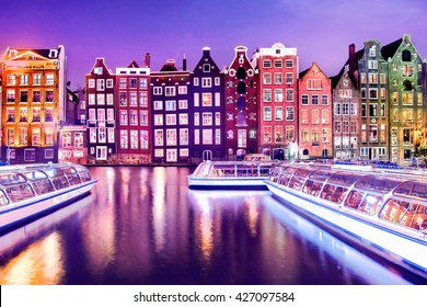 Traditional Dutch old houses on the canals in Amsterdam at night, The Netherlands