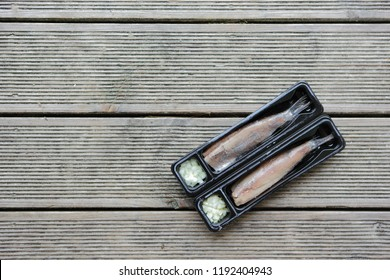 Traditional Dutch raw herring with onions on wooden background