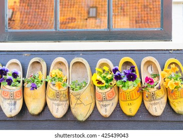 Traditional dutch shoes clogs with fresh flowers