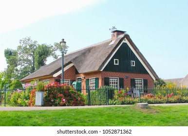 Traditional Dutch straw roof house with shutters and garden, Giethoorn, Netherlands