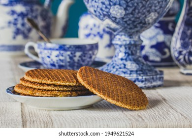 Traditional Dutch stroopwafel with syrup, cookie and tea, Dutch blue decorative crockery on the table,macro photo