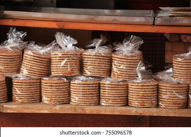 """Traditional Dutch stroopwafels, a traditional sweet cookie, filled with caramel syrup. These are wrapped in plastic to keep them soft. Text in the small closing clip is the """"best before"""" date"""