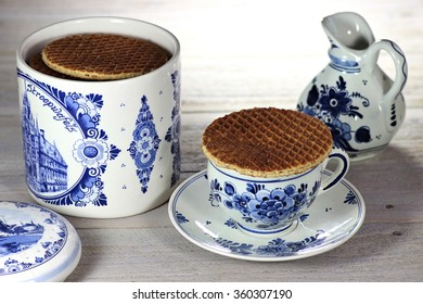 traditional dutch syrup waffles with delftware on wooden background
