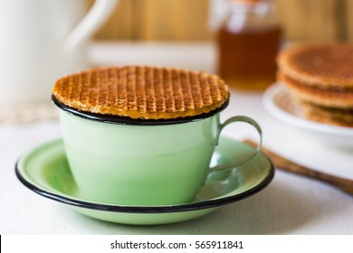 Traditional Dutch waffle called Stroopwafel on a cup of coffee