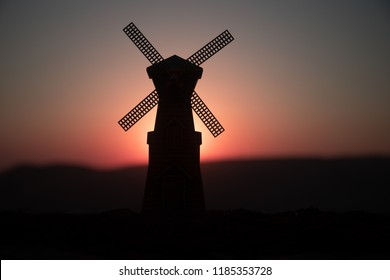 Traditional, Dutch windmill at a hill during a summer sunset. Decoration. Selective focus