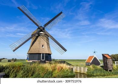 A traditional dutch windmill near Hoorn,Netherlands