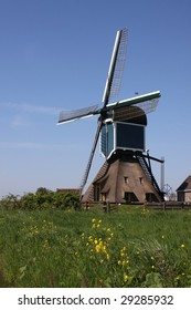 Traditional Dutch windmill used to pump water out of a polder