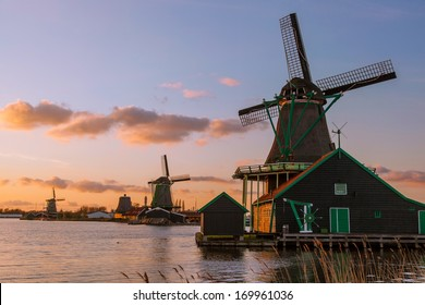 Traditional Dutch windmills with canal in Zaanse Schans near the Amsterdam, Holland