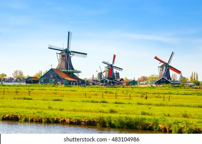 Traditional dutch windmills and houses near the canal in Zaanse Schans, Netherlands, Europe