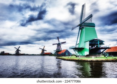 Traditional dutch windmills near the canal. Netherlands