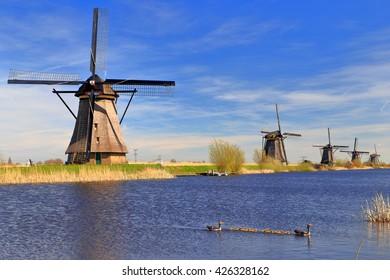 Traditional Dutch windmills near a canal in Kinderdijk, Holland