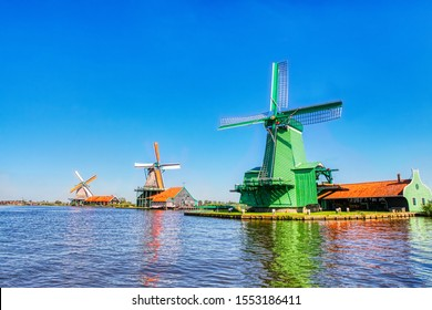 traditional dutch windmills of the Netherlands one of the main tourists attractions in Holland, shot in Zaanse Schans