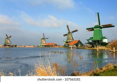 Traditional dutch windmills in the quaint village of Zaanse Schans, the Netherlands